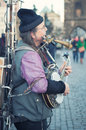 Allround entertainer prag czechoslovakia februar a solo makes music on the charles bridge in prague he plays different kinds of Stock Images