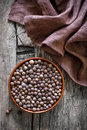 Allspice peppercorns in a bowl on a vintage wooden table Royalty Free Stock Images