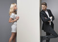 Alluring blonde girl trying to catch her boyfriend Royalty Free Stock Images