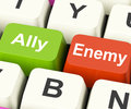 Ally enemy keys mean partnership and opposition meaning Royalty Free Stock Photography