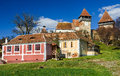 Alma vii medieval village transylvania romania rural scenery with fortified churches rural church was built in th century by Stock Photos