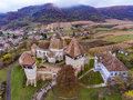 Alma Vii saxon fortified Church in Transylvania, Romania. Artist Royalty Free Stock Photo