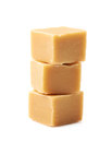 Almond butter toffee cube isolated pile of cubes over the white background Royalty Free Stock Images