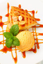 Almond cake with ice cream and caramel sauce scoop of Royalty Free Stock Images