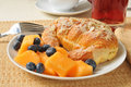 Almond croissant with cantaloupe and blueberries a custard filled juice Stock Images