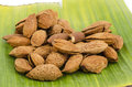Almond on green banana leaves a grain that provide health benefits Royalty Free Stock Photo
