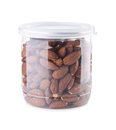 Almond in jar on background Royalty Free Stock Photo