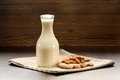 Almond milk in bottle with raw almonds Royalty Free Stock Photo