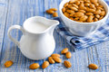 Almond milk and kernels on a table Royalty Free Stock Photos