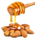 Almond nuts and honey Royalty Free Stock Photo