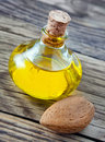 Almond oil against a wooden background Stock Photography