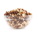 Almond pistachio peanut walnut hazelnut mix mixed in a glass bowl over white background Royalty Free Stock Photo