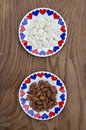 Almond and pumpkin seed in ceramic plate with hearts healthy food Stock Image