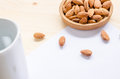 Almond snack on wooden table: breaking time in office Royalty Free Stock Photo