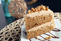 Almond toffee cake slice of with coffee flavored icing Stock Image