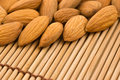 Almonds on a bamboo mat. Royalty Free Stock Photography