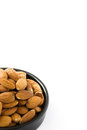 Almonds in black bowl isolated Royalty Free Stock Photo