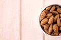 Almonds in the cup selective focus on and blank space on left side Royalty Free Stock Image
