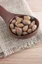 Almonds kernel in awooden spoon wooden close up photo Stock Photography