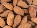 Almonds nuts closeup of a pile of Stock Photo