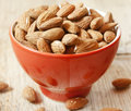 Almonds placed in a red bowl healthy fruits Stock Images
