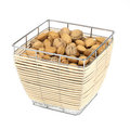 Almonds and walnuts in a food basket isolated Royalty Free Stock Image