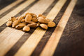 Almonds on wood in beautiful lighting interesting cutting board Royalty Free Stock Image
