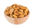 Almonds in wood bowl isolated Royalty Free Stock Photo