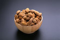 Almonds in wooden bowl on a black background Royalty Free Stock Photo