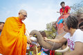 Almsgiving in thailand ayutthaya apr thai people and elephant jointly give alms to monks during songkran festival on apr ayutthaya Royalty Free Stock Image