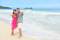 Aloha couple on hawaiian beach hawaii vacations portrait of of tourists happy standing at their vacation asian women and caucasian Stock Photography