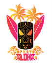 Aloha Vector illustration of tiki mask with surf boards and Hawaiian Plants and Tropical Flowers Royalty Free Stock Photo