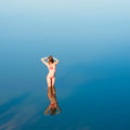 Alone girl in water Royalty Free Stock Photo