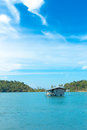 Alone home among the blue sea and blue sky Royalty Free Stock Photos