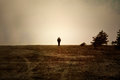 Alone on moor image textured with soft sandstone of human walking a Stock Photography