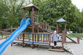 Alone playground with one child in the park Royalty Free Stock Photography