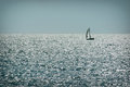 Alone sailing ship on water in good weather. Yachting Royalty Free Stock Photo