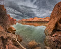 Along the colorado river serene on a cloudy day near moab ut Stock Photography