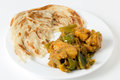 Aloo capsicum curry and paratha potato bell pepper vegetarian served with fried flatbread in the traditional way Stock Image