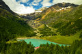 Alp grum in switzerland photo shows small village beautiful landscape on mountains forest and azure lake Royalty Free Stock Photography