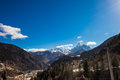 Alp peak in a sunny spring day mountain village below the snowy Stock Photography