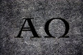 Alpha and Omega in stone Royalty Free Stock Photo