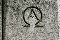 Alpha Omega Symbol Carved in Stone Royalty Free Stock Photo