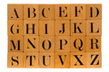 Alphabet antique block wood Arkivfoto