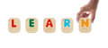 Alphabet blocks spelling the word LEARN with Braille Royalty Free Stock Photo