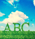 Alphabet letters abc made grass vintage effect textured background Stock Photos