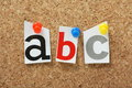 Alphabet letters the a b and c pinned to a cork notice board Royalty Free Stock Photo