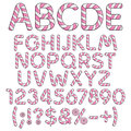 Alphabet, letters, numbers and signs from pink and white sweets. Royalty Free Stock Photo