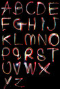 Alphabet light neon writing long exposure the letters a b c d e f g h and i written in the dark with torches and lasers Royalty Free Stock Photo