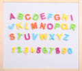 Alphabet made ​​of plastic letters on a magnetic board Royalty Free Stock Photo